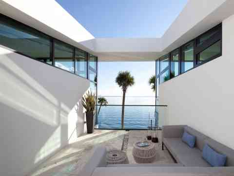 Outdoor Living Space And Water View Miami